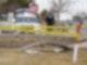 Ein Trümmerteil eines Flugzeugs liegt auf einer mit Polizeiband abgesperrten Fläche. Foto: David Zalubowski/AP/dpa
