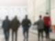 Männliche Asylbewerber gehen über das Gelände der Zentralen Ausländerbehörde (ZABH) in Eisenhüttenstadt. Foto: Patrick Pleul/dpa-Zentralbild/dpa