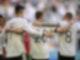 Deutschlands «Man of the Match» Robin Gosens (M) feiert mit Kai Havertz und Toni Kroos (r). Foto: Philipp Guelland/EPA Pool/dpa