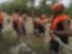 Rettungskräfte in Cagayan helfen während einer Evakuierung einem Kind. Foto: PHILIPPINE COAST GUARD/AP/dpa